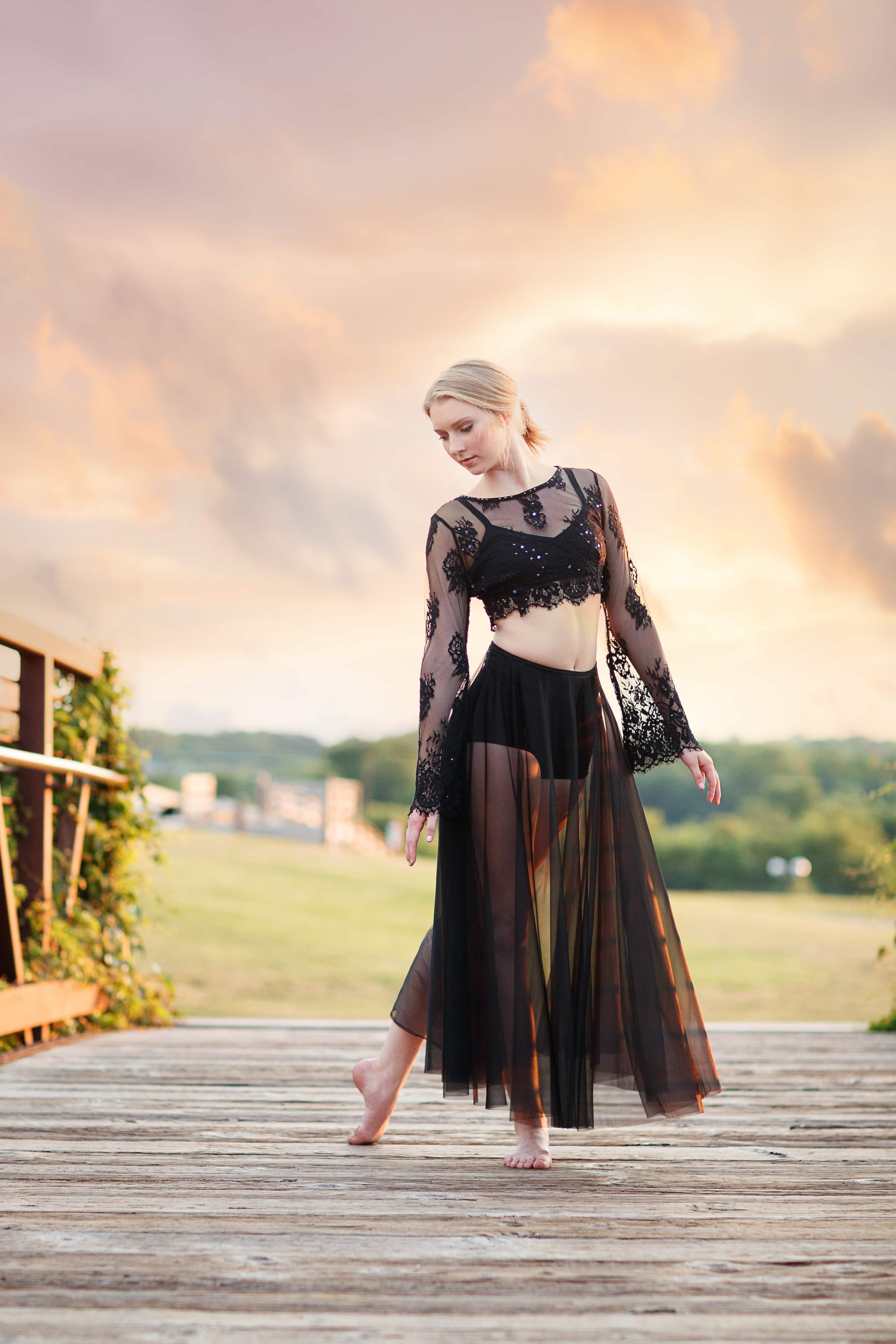 senior girl dancer in black at sunset