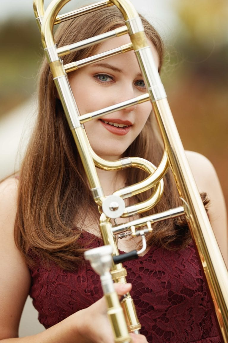 Senior girl photography session with trombone instrument