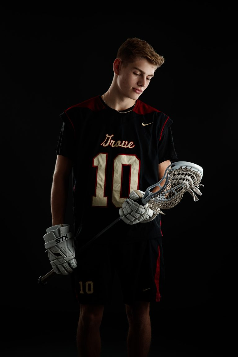 Senior guy hold a lacrosse stick