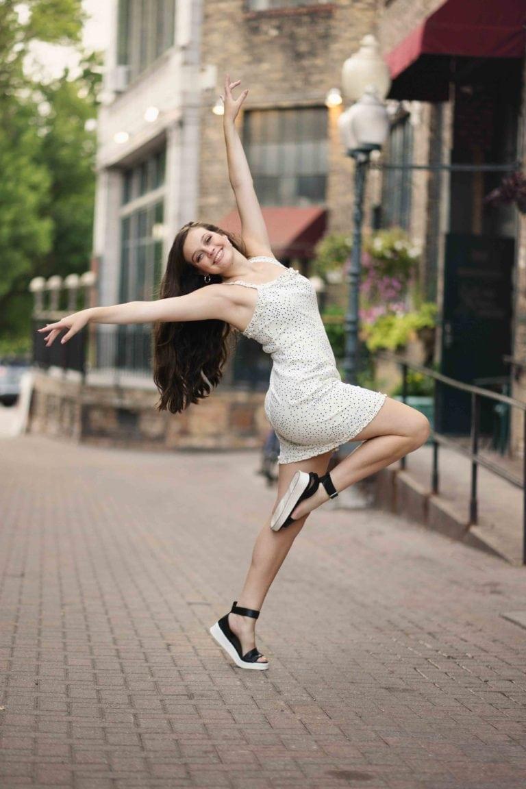 Senior girl photoshoot striking a pose in the city of Minneapolis