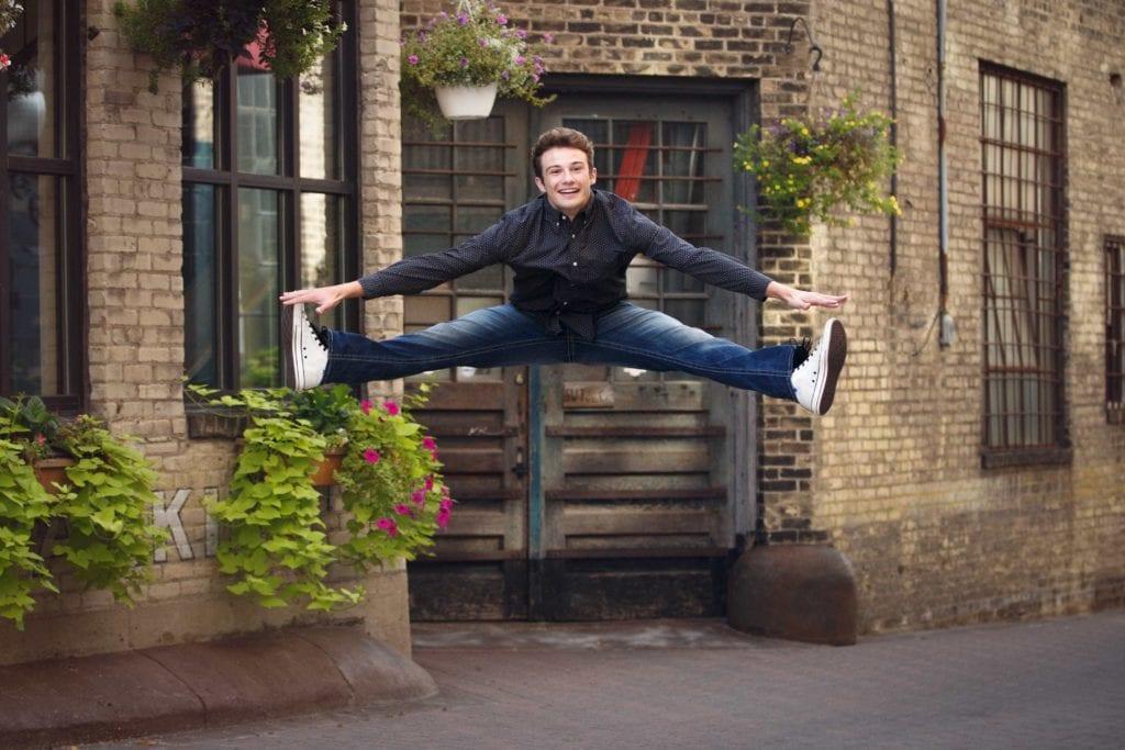 Senior guy jumping.