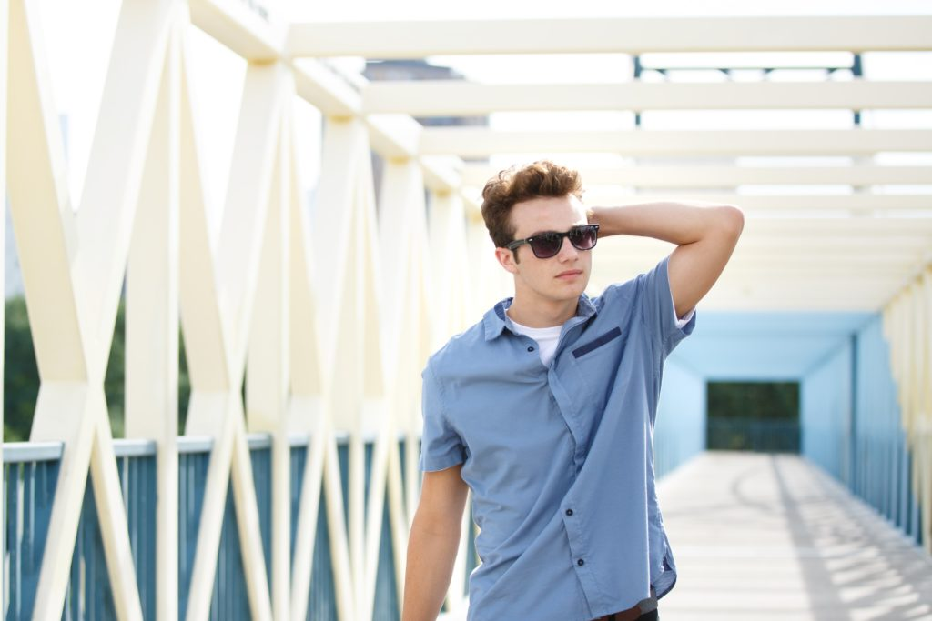 Senior guy wears sunglasses on a bridge in minneapolis