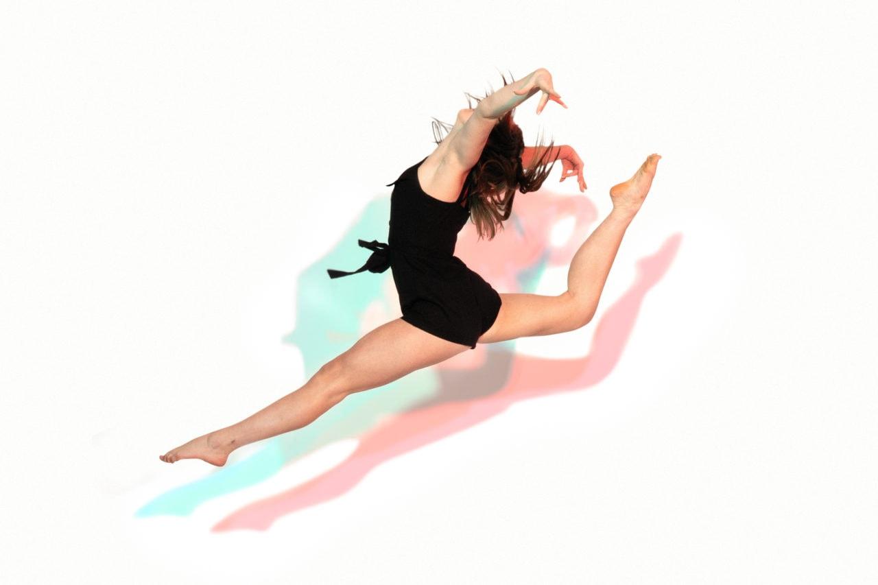 studio senior picture of dancer against white wall